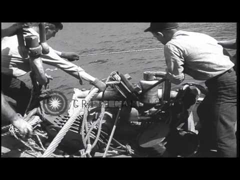 Crew aboard USS Current try to salvage a sunken Japanese vessel off Pearl Harbor ...HD Stock Footage
