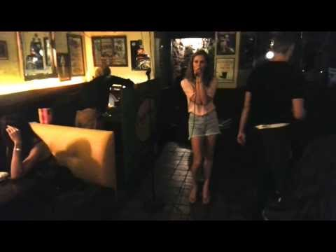 Very nice singer performs karaoke at the Paddy Whelan's Irish Pub : )