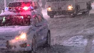New York City Police Department Responding Thru Times Square in a Snowstorm