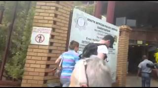 Oscar Pistorius arrives at police station to perform community service