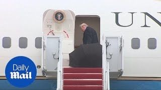 Donald Trump just LEAVES his open umbrella outside the plane