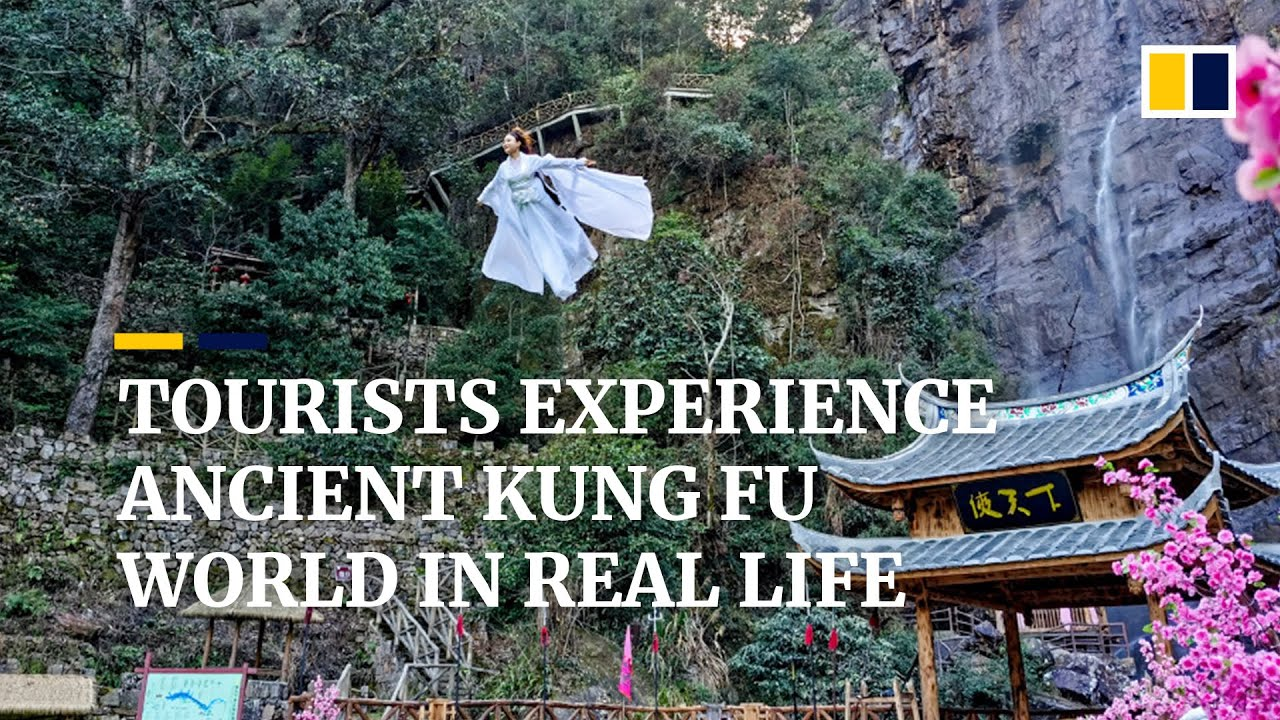 Dressed in costumes, tourists 'fly' into the sky to experience real life kung fu world