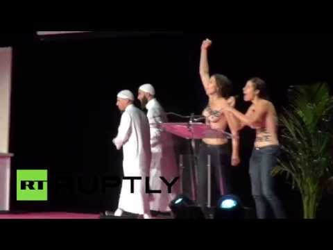 Topless FEMEN activists disrupt Muslim conference in France