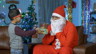 Lonely Santa gets a surprise gift from a cute little boy during Christmas Eve in India