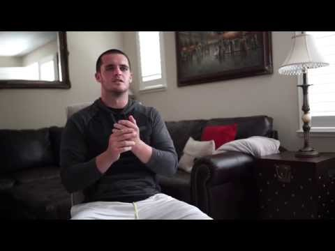 What is the meanings of Derek Carr's tattoos on his wrists?