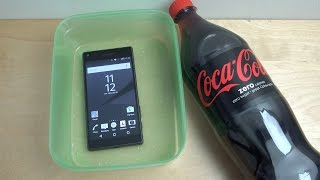 Sony Xperia Z5 Compact - Coca-Cola Test (4K)(As you requested today we are going to test the Sony Xperia Z5 Compact with Coca Cola to see if it survives in a liquid. Can the Z5 Compact handle harsh ..., 2015-09-30T12:09:57.000Z)