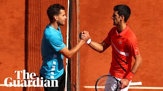 Djokovic fumes over 'hurricane conditions' as Thiem advances to French Open finals