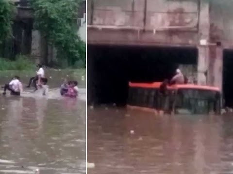 Cops rescue school children trapped in waterlogged underpass - YouTube