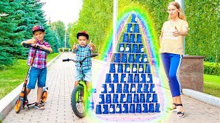 Erik and Gleb play with colored cups and cycling on bike.