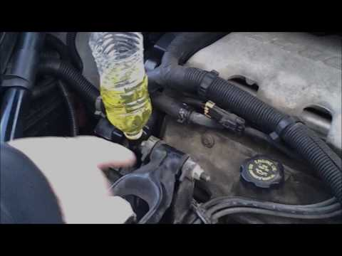 Removing air pockets in engine  with plastic bottle
