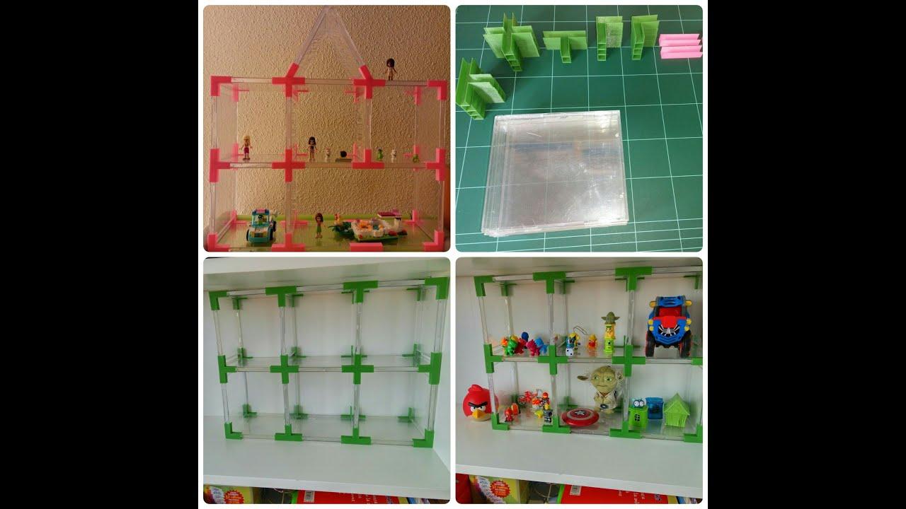 como hacer estanteras para juguetes con cajas de cd recicladas