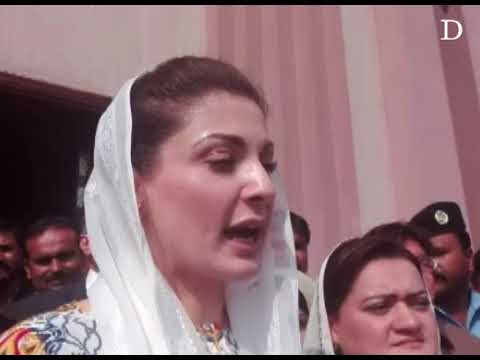 Maryam Nawaz talks to reporters outside the court
