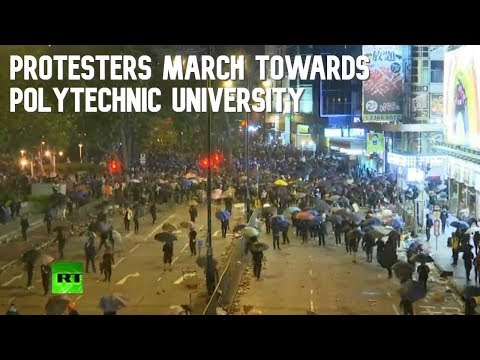 Hong Kong protesters march towards Polytechnic University