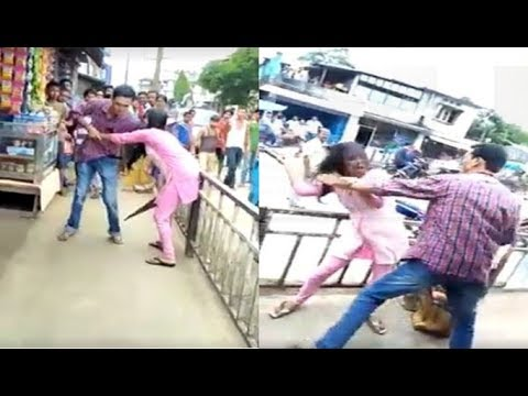 Man beats girl in public, crowd watches silently