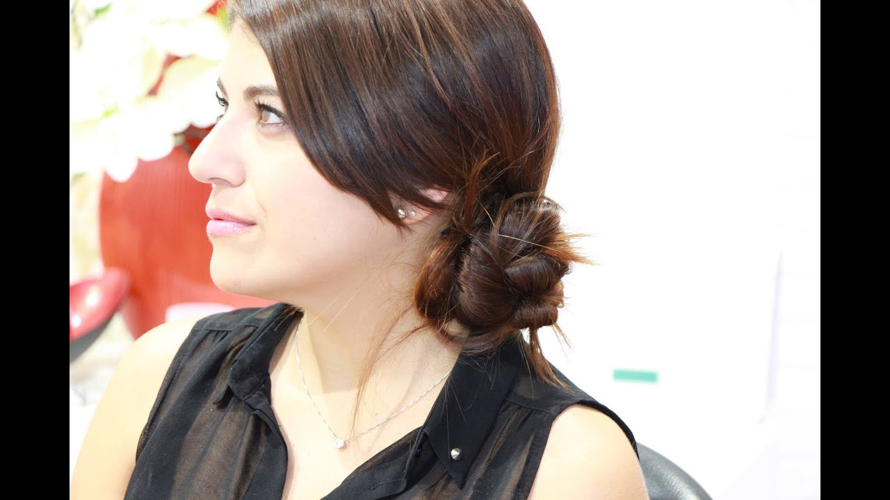 Peinado recogido bajo lateral