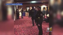 Police Storm Evanston Theater With Guns Drawn
