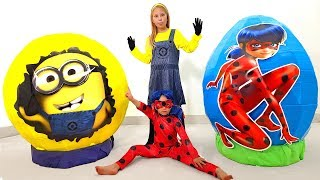 Kids play with toys in Giant Surprise eggs Ladybug & Minions