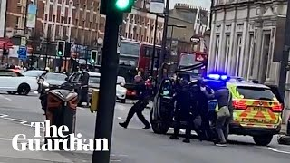 streatham-police-arrive-on-the-scene-after-man-shot-by-armed-officers-in-terror-incident
