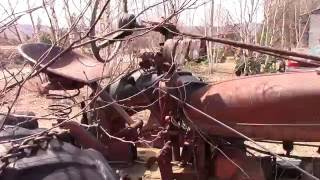 1950's Farmall H tractor and old Ford logging truck