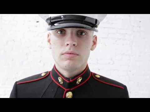 Marine Putting on Hat