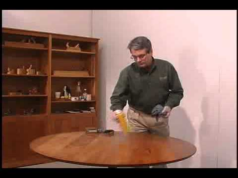 Lying A Wax Polish To Wood Furniture Re The Er And Add Protective Film