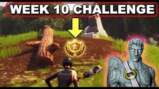 Search between a Stone Circle, Wooden Bridge, and a Red RV - Week 10 Challenges Fortnite