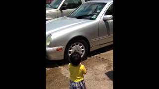 Ahrod is washing cars for celebration of his 19 months old