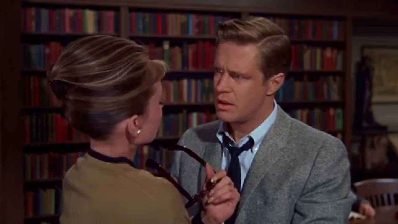 breakfast at tiffany s paul tells holly in the library he loves