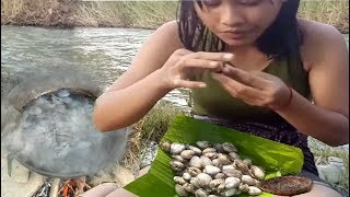cooking in forest-  Cooking roasted oyster on a rock and eating delicious