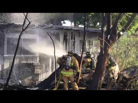 Raw: Crews put out structure fire by Kalani High School