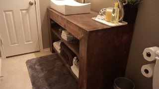 DIY quick and easy bathroom vanity that looks gorgeous! Wood: Sande Plywood Stain: 1 qt. PolyShades Honey Satin Stain and
