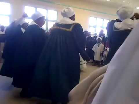 Bulela M singing at his Church