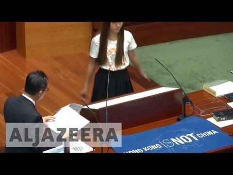 China bars two rebel Hong Kong MPs from retaking oath