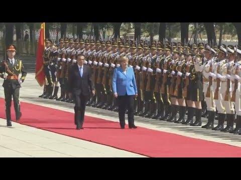Merkel besucht Peking: Wie Trumps Drohkulisse Deutschland und China zusammenschweißt