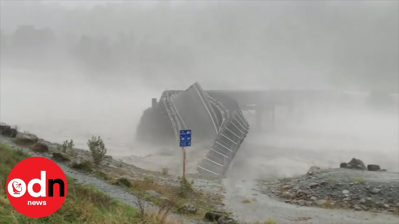 Bridge washed away by raging floodwater in New Zealand