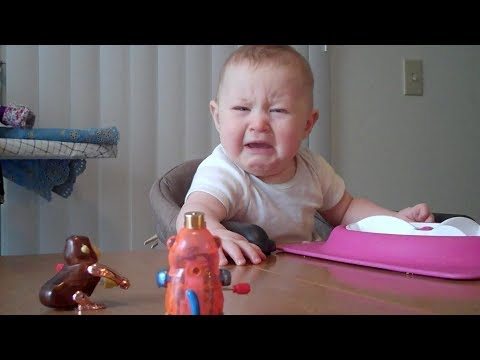 Baby is freaked out by monkey toy   Unhappy Babies and Toddlers   toddletale