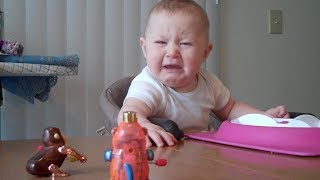 Baby is freaked out by monkey toy | Unhappy Babies and Toddlers | toddletale
