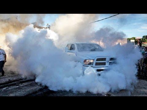 4X4 BURNOUT - 15,000lbs Dumpster vs 8000lbs Dodge Ram Pickup