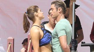 Alexandra Daddario and Zac Efron get flirty