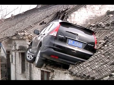 Suv Crashes Into House Roof After Mistaking Accelerator For Brake