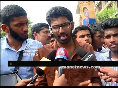 Students protest against KTU's 'year back' system at Marine Drive, Kochi