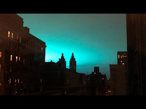 Eerie blue glow lights up the skies above New York City