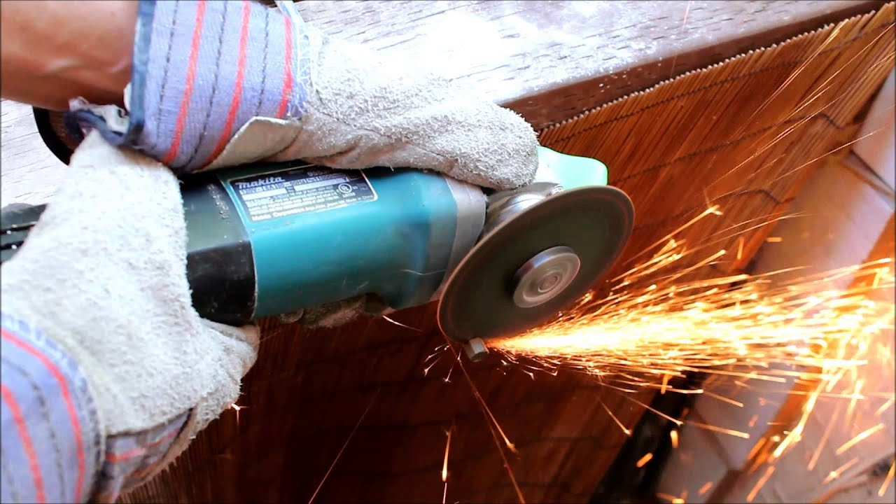 Makita angle grinder in action cutting stainless steel rod youtube dailygadgetfo Image collections
