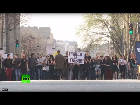 Serbian students protest outside Belgrade police station demanding the release of a fellow student