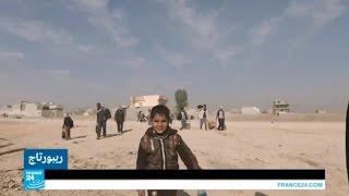مسيرة آلاف النازحين العراقيين من الموصل إلى مخيمات اللجوء