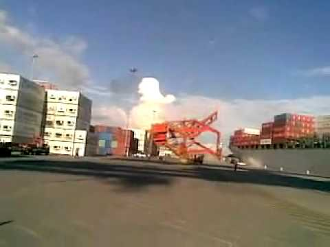 Ship hits dockside crane.