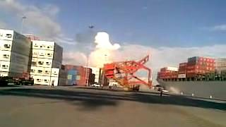 Ship hits dockside crane.