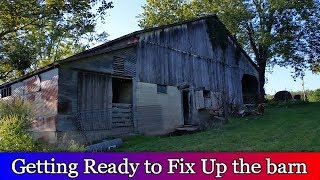 Cleaning up the old barn, so we can fix it up.