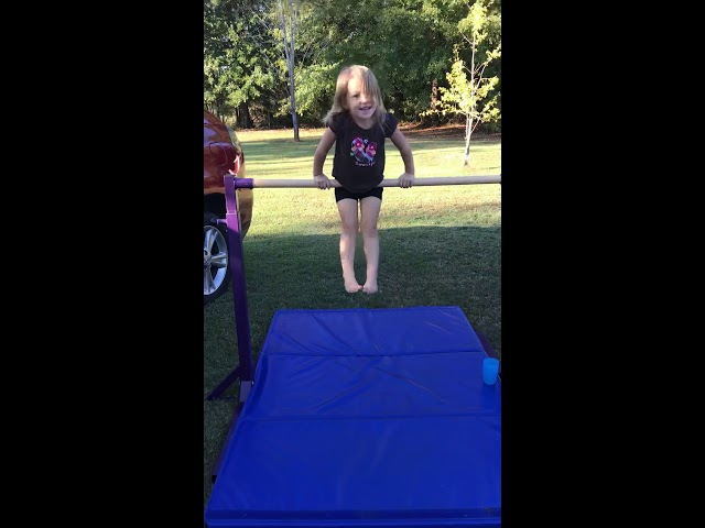3 Year old doing pullover. Laiah loves gymnastics! Bars are her current favorite.