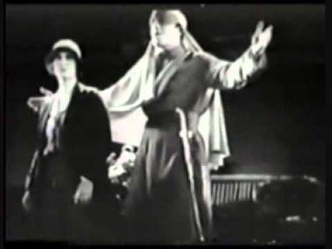 John Boles and Carlotta King sing the title song from